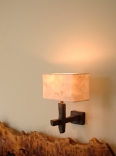 Contemporary bronze wall light with hand made eucalyptus paper lamp shade by Hannah Woodhouse.